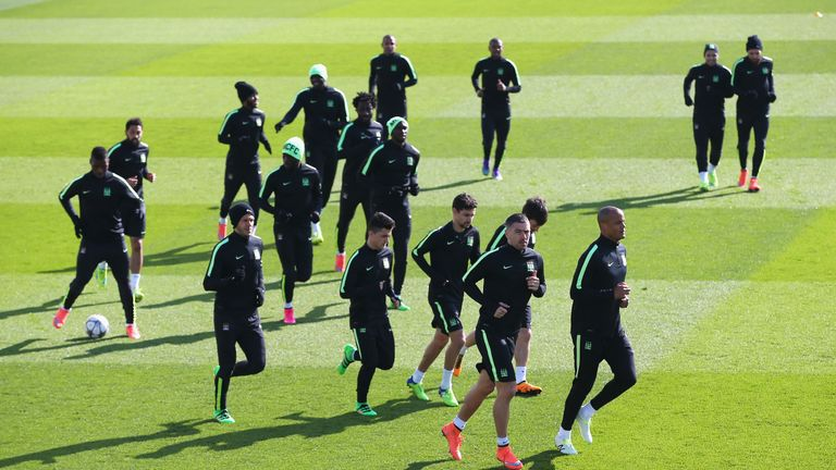 Vincent Kompany leads his players in the warm up
