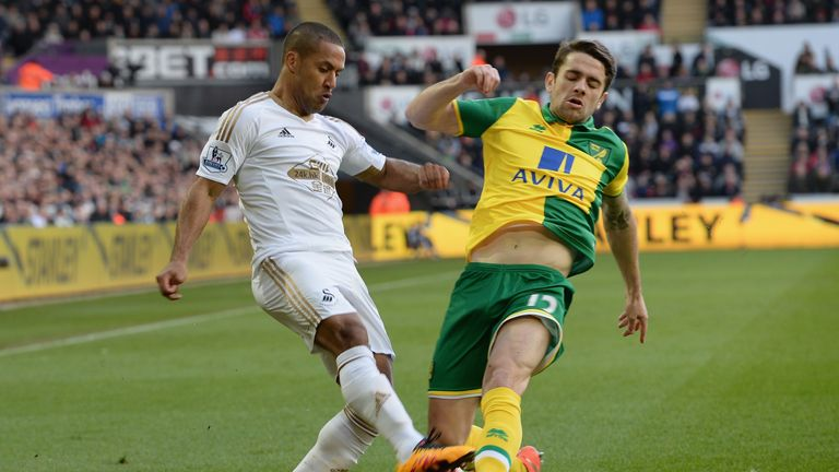 Wayne Routledge is tackled by Robbie Brady