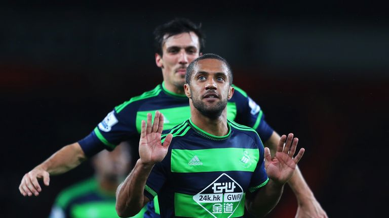 Wayne Routledge celebrates after scoring against Arsenal