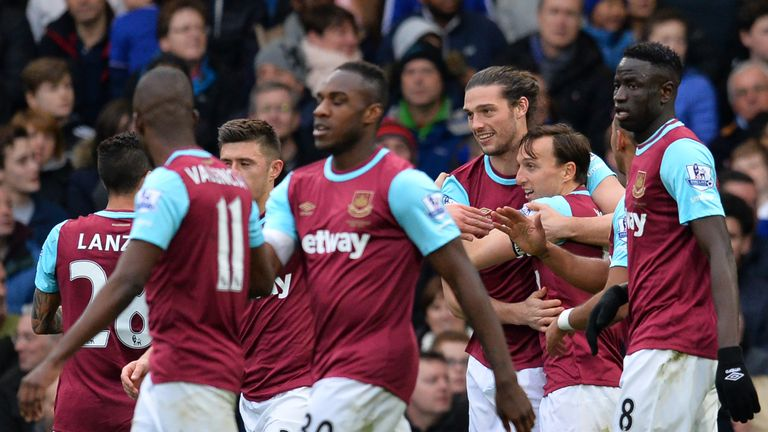 Andy Carroll celebrates with his team-mates after scoring with his first touch