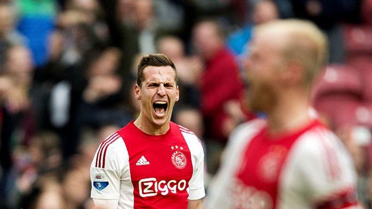 Arek Milik of Ajax celebrates after scoring a goal to equalise 2-2