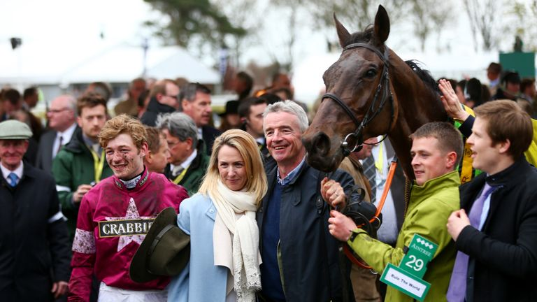 Michael and Anita O'Leary and David Mullins pose in the Winners' Enclosure after Rule The World won the 2016 Grand National