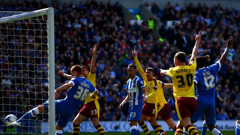 Sidwell hooks a ball clear of the line while playing for Brighton