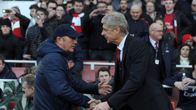 Tony Pulis (left) and Arsene Wenger clashed during Pulis' time as Stoke manager