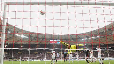Stuttgart keeper Przemyslaw Tyton makes a dramatic save at the Mercedes-Benz Arena but he was unable to prevent Bayern Munich from winning 3-1