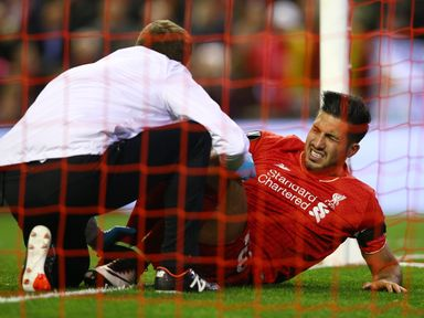Emre Can receives treatment before being substituted against Dortmund