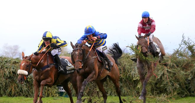 The Last Samuri leads the Grand National field over the last fence.