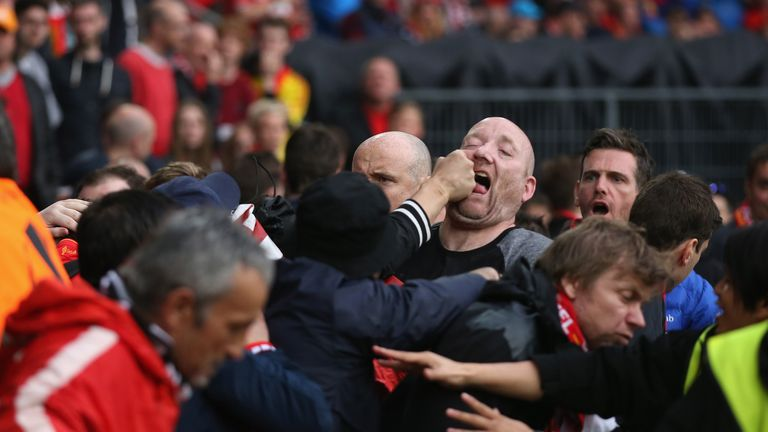 Fans scuffle prior to the UEFA Europa League final