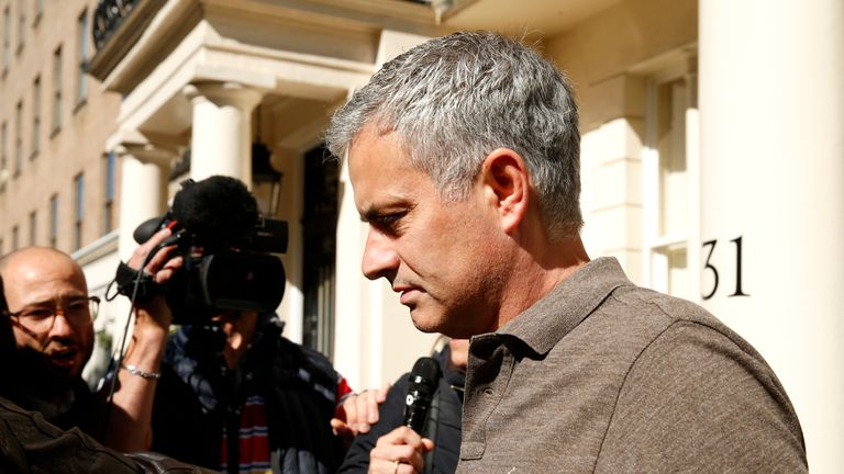 Mourinho speaks to the press as he leaves his house in London on Tuesday