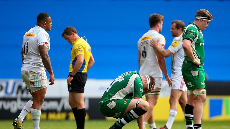 London Irish players dejected after their loss to Harlequins