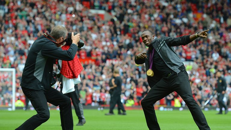 Usain Bolt shows off his gold at Old Trafford shortly after the London 2012 Olympics