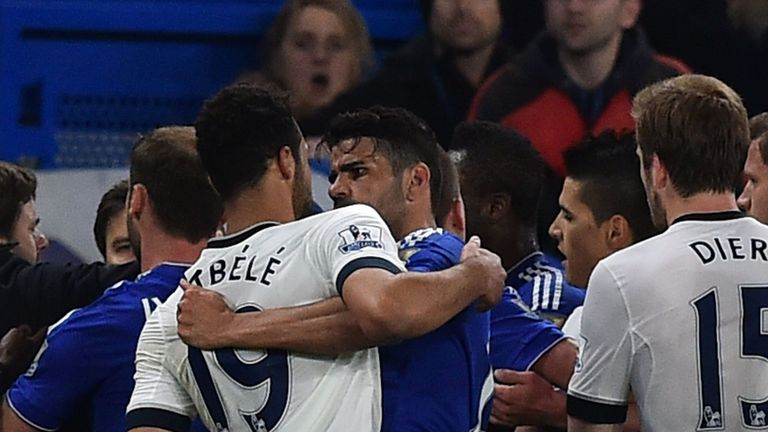Mousa Dembele (left) and Diego Costa clash just before half-time