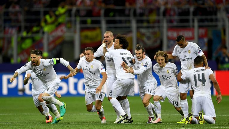 Real Madrid players celebrate after Ronaldo's winning penalty