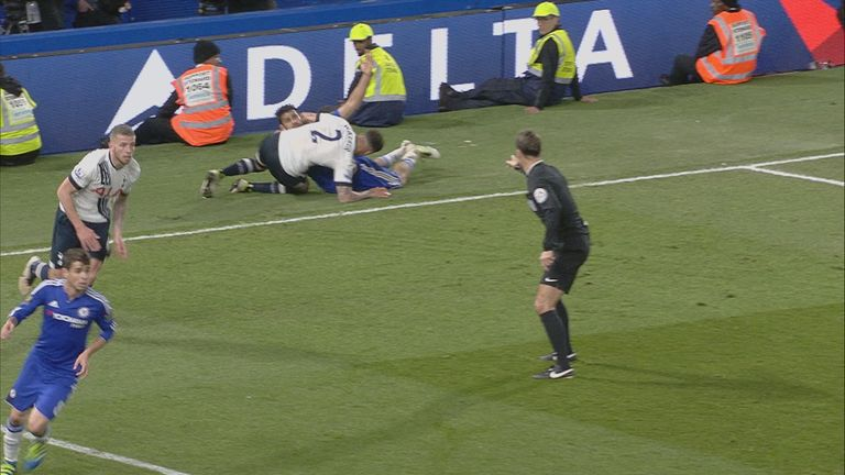 Diego Costa and Kyle Walker get tangled up after colliding in Tottenham's penalty area