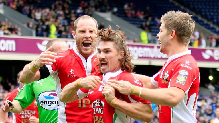 Jarrod Sammut (centre) celebrates scoring a debut try against Bradford at the 2010 Magic Weekend