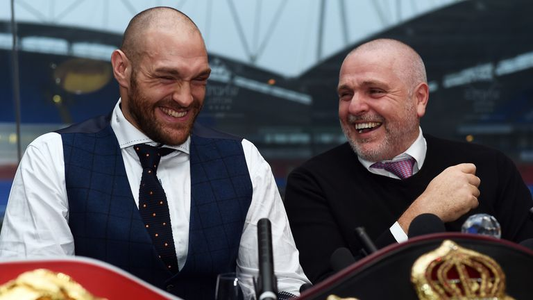 Tyson Fury (left) will not retire after his next fight, says Peter Fury