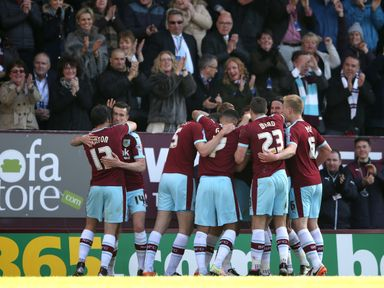 Burnley goalscorer Sam Vokes is mobbed by his team-mates