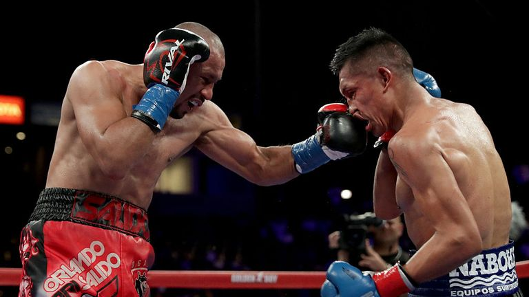 Orlando Salido (L) lands a powerful left hand to the head of Francisco Vargas