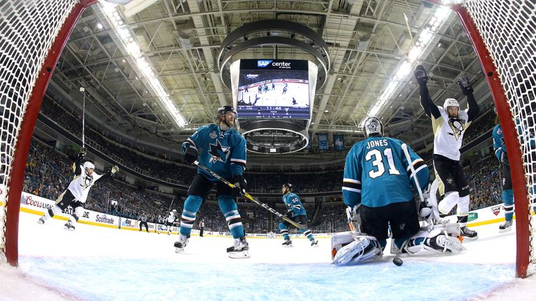 Martin Jones #31 of the San Jose Sharks allows a goal to Brian Dumoulin #8 of the Pittsburgh Penguins in the first period