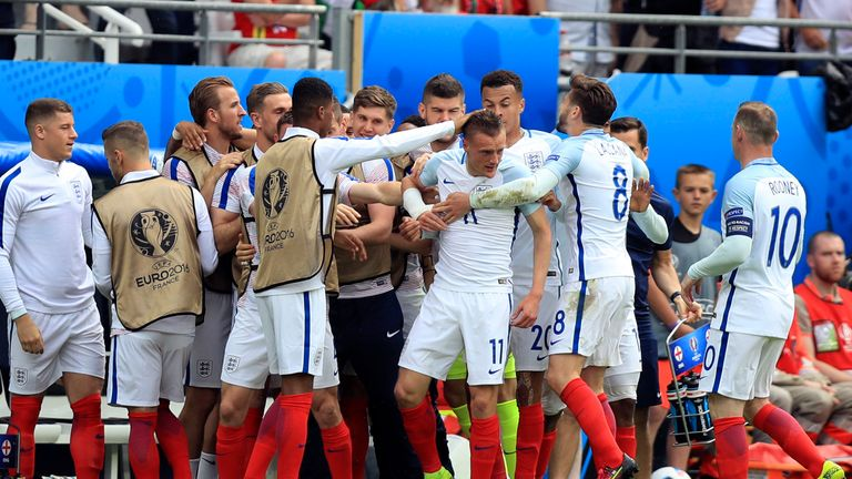 Vardy celebrates with team-mates after equalising for England