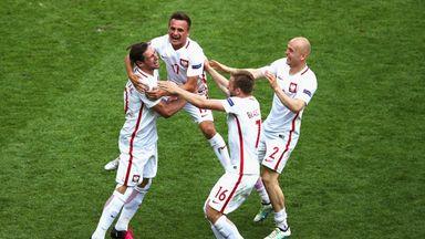 Grzegorz Krychowiak celebrates after scoring the winning penalty