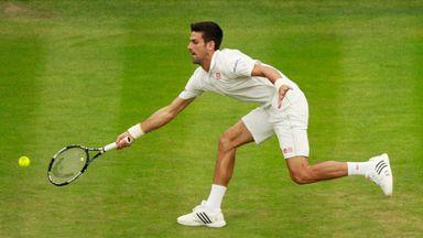 Novak Djokovic stretches to play a forehand