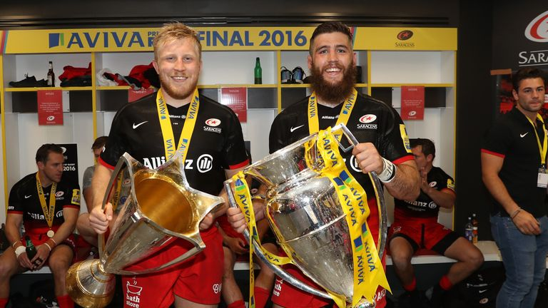 Fraser and fellow back row Jackson Wray celebrate their 'double' success with the European Cup and Premiership trophies
