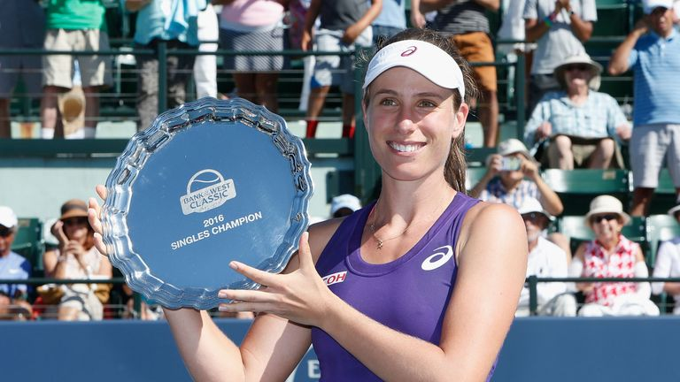 Konta shows off her trophy after Stanford success