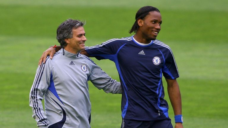 Mourinho (left) shares a joke with Didier Drogba in their Chelsea days
