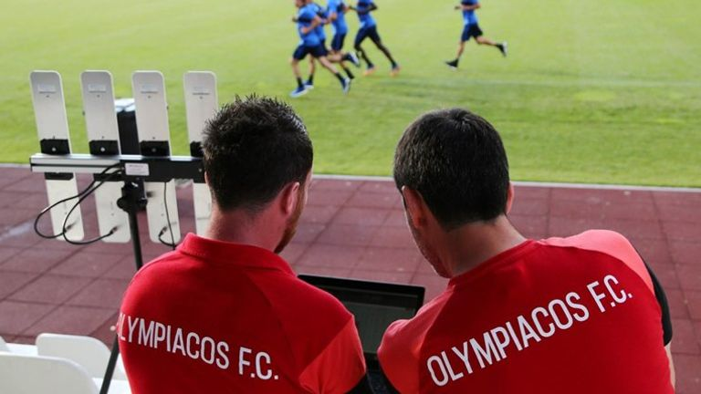 Technical staff at Greek side Olympiakos monitor STATSport data during training