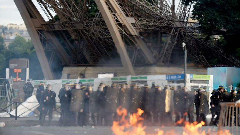 French riot policemen fired tear gas after supporters tried to enter the fan zone