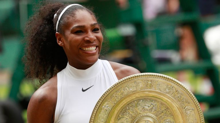 Serena Williams celebrates with the Wimbledon trophy