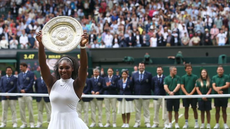 Williams poses with the winner's trophy, the Venus Rosewater Dish, after her women's singles final victory over Germany's Angelique Kerber