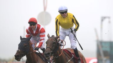 Big Orange ridden by jockey Jamie Spencer (centre) coming home to win the 2016 Qatar Goodwood Cup .