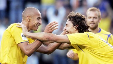 Larsson and Ibrahimovic (right) celebrate a Sweden goal