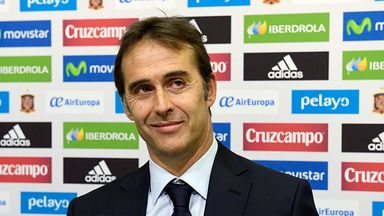 Julen Lopetegui smiles during a press conference following his appointment as new manager of the Spain national team