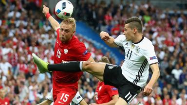 Kamil Glik beats Germany's Toni Kroos to the ball