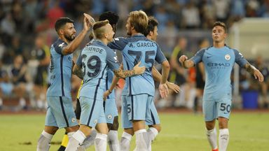 Sergio Aguero congratulated by team-mates after his opener in Shenzhen