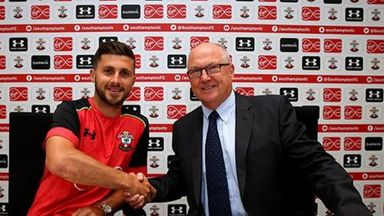 Shane Long and Les Reed celebrate the forward