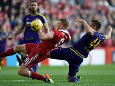 Adam Rooney and Denis Sme battle for the ball