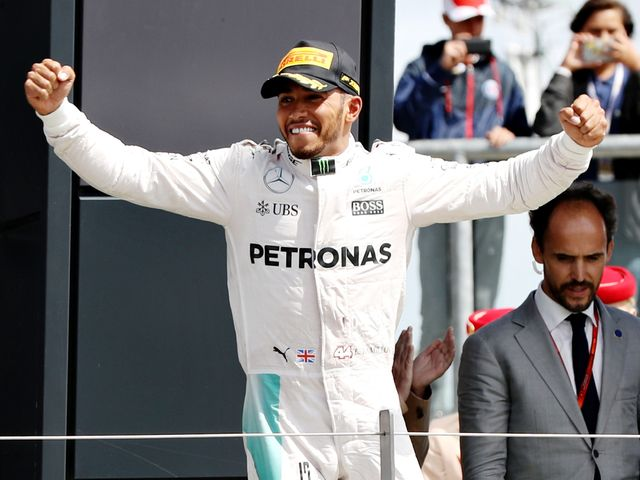 Hamilton celebrates on the podium
