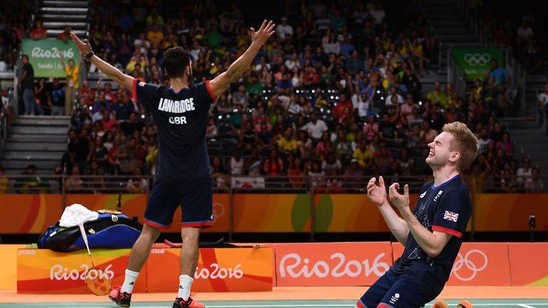 Chris Langridge and Marcus Ellis of Great Britain celebrate after winning badminton bronze