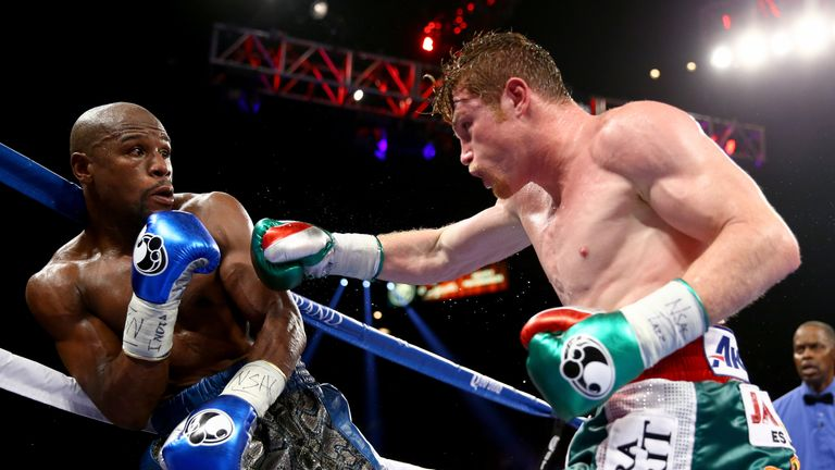 Floyd Mayweather  secured a  majority decision over Canelo Alvarez when they met