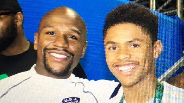 Shakur Stevenson (R) poses with Floyd Mayweather after winning an Olympic medal