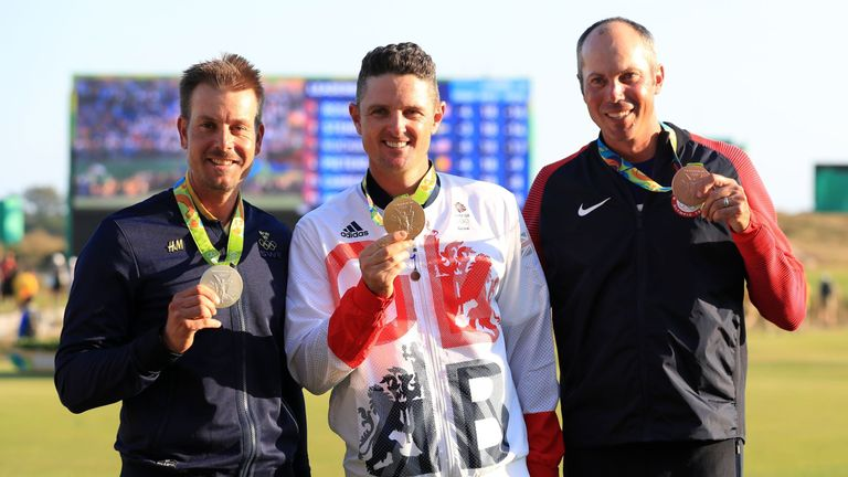 Great Britain's Justin Rose (centre) celebrates winning gold ahead of Sweden's Henrik Stenson (left) and Matt Kuchar