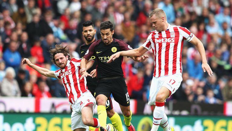 Joe Allen (L) in action for Stoke