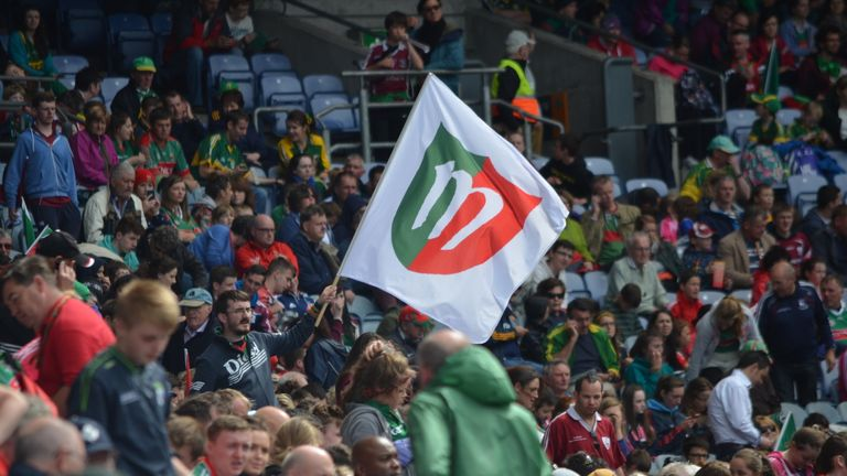 Mark Togher (holding flag) predicts a huge atmosphere on Sunday