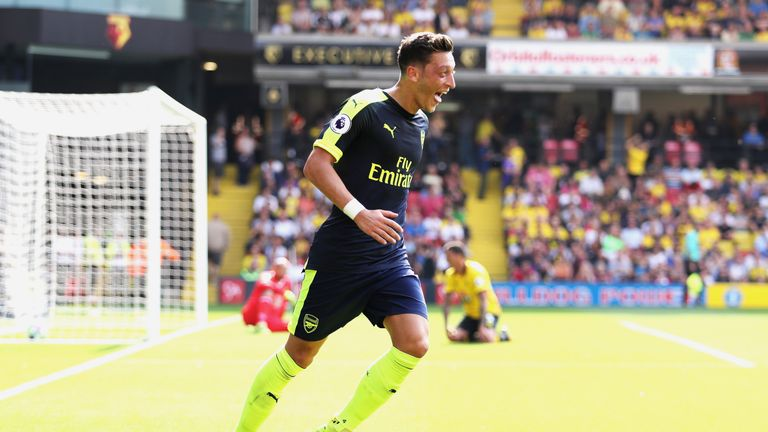 Mesut Ozil celebrates scoring Arsenal's third goal