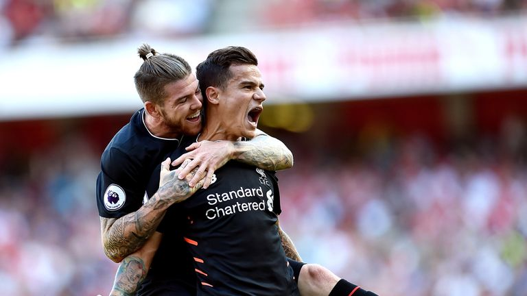 Philippe Coutinho celebrates after scoring the equalising goal