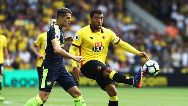 Troy Deeney of Watford controls the ball infront of Granit Xhaka